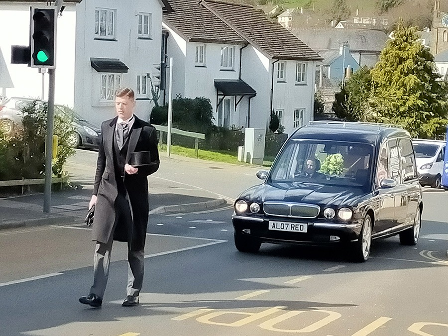 David paging the hearse as it leaves our chapel of rest